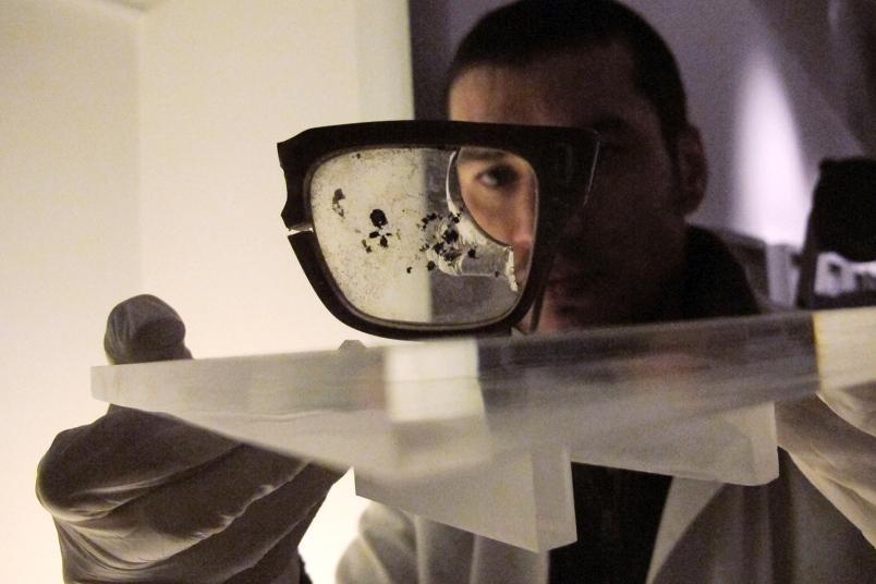 National Museum worker shows the broken eyeglasses of Chile's late President Salvador Allende in Santiago, Chile